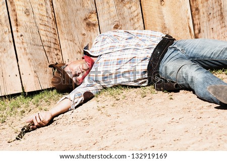 SOUT WEST - A cowboy dead with arm in his hand - stock photo