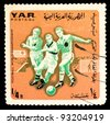 SOUTH AFRICA - CIRCA 1974: a stamp printed in SOUTH AFRICA, shows football world championship, three players are running for ball, circa 1974 - stock photo