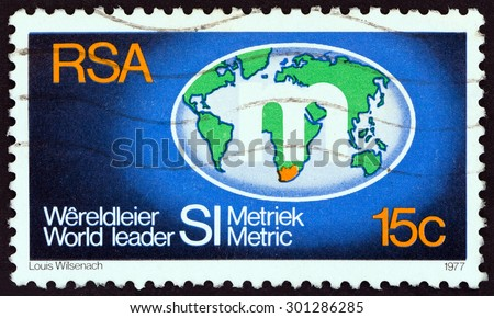 SOUTH AFRICA - CIRCA 1977: A stamp printed in South Africa shows Metrication Symbol on Globe, circa 1977. - stock photo