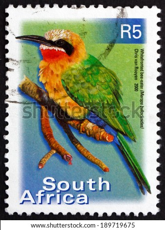 SOUTH AFRICA - CIRCA 2000: a stamp printed in South Africa shows White-fronted Bee-eater, Merops Bullockoides, Bird, circa 2000 - stock photo