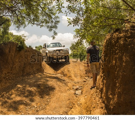 South Africa, Gauteng, Hennops off-road trail - 06 February, 2016. Four-wheel drive vehicle Toyota Hilux is doing off-road trail with unidentified man .