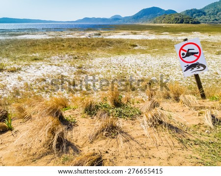 South Africa, Isimangaliso wetland park, crocodile warning and no swimming sign  - stock photo