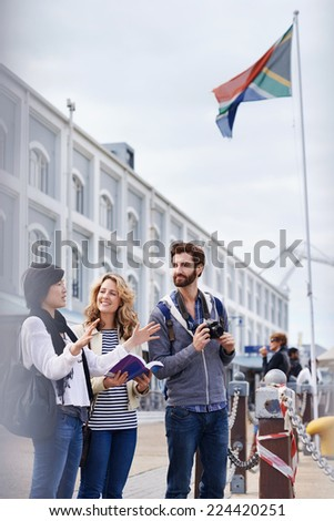 South Africa tourism couple with guide book on vacation holiday