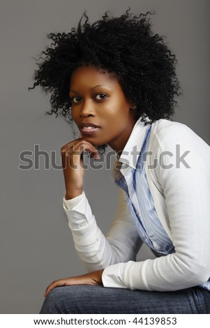 South African business woman with long curly afro - stock photo