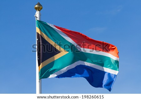 South African flag on the blue sky - stock photo
