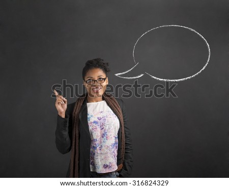 South African or African American black woman teacher or student with a good idea or answer with speech bubble standing against a chalk blackboard background inside