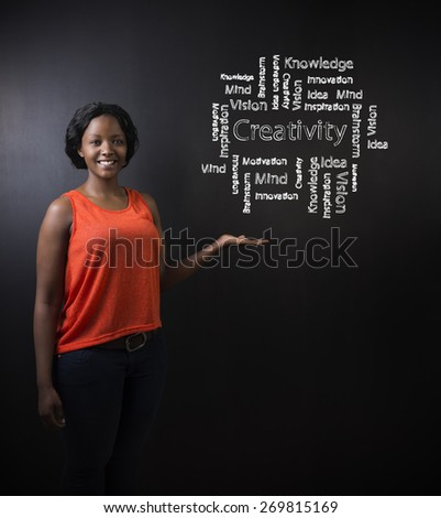 South African or African American woman teacher or student against blackboard background with chalk creativity diagram - stock photo