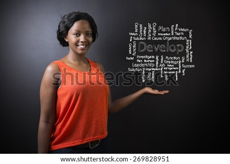 South African or African American woman teacher or student against blackboard background with chalk develop diagram - stock photo