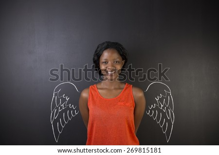 South African or African American woman teacher or student angel with chalk wings on blackboard background - stock photo