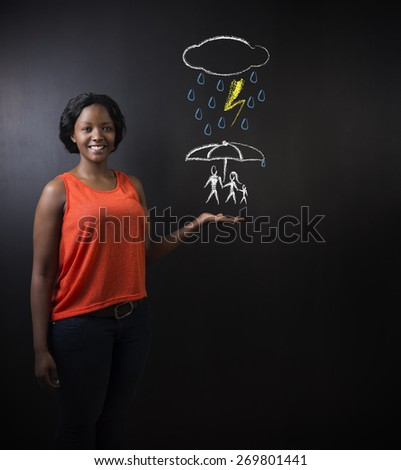 South African or African American woman teacher or student thinking about protecting family from natural disaster on blackboard background - stock photo
