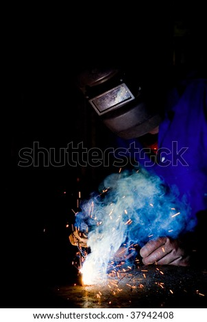 South African or American black worker welding - stock photo
