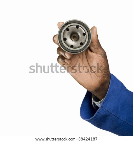 South African or American blue collar mechanic hand with oil filter isolated on white