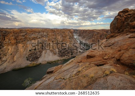 South African river flowing from Augrabies Waterfall - stock photo