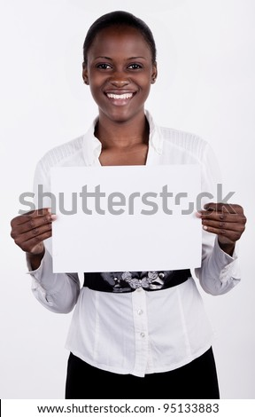 South AFrican woman holding up a blank paper for copyspace. - stock photo