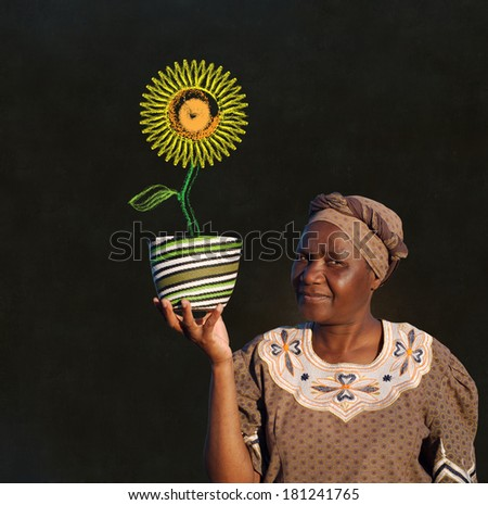 South African Zulu woman basket sales woman blackboard sunflower - stock photo