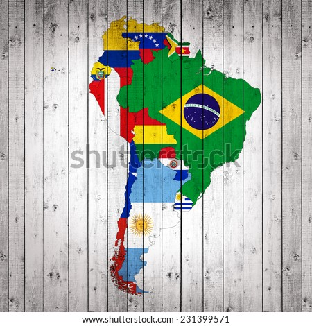 South America,continent, flags, maps,and wood background - stock photo