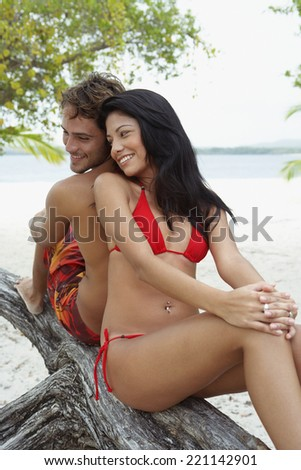 South American couple at beach - stock photo