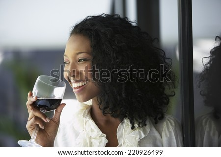 South American woman drinking wine - stock photo