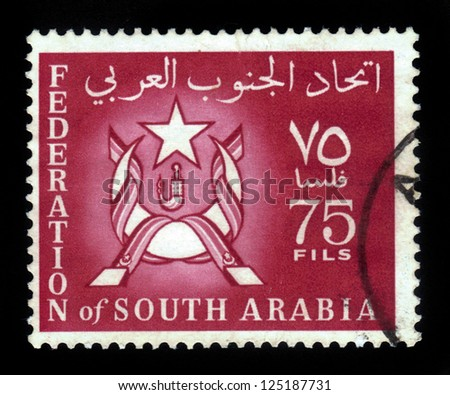 SOUTH ARABIA - CIRCA 1966: A stamp printed in Federation of South Arabia shows the image of the coat of arms of Federation of South Arabia, circa 1966 - stock photo