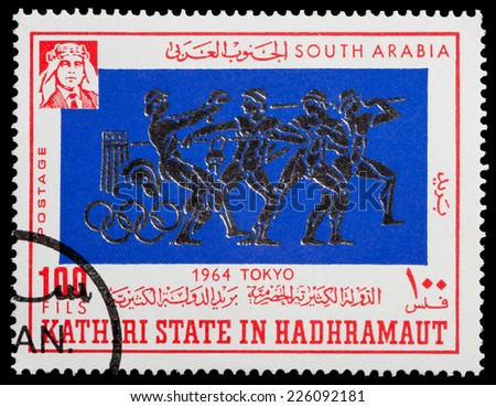 SOUTH ARABIA - CIRCA 1966: A stamp printed in South Arabia in Kathiri state in Hadhramaut honoring Olympic Games in Tokyo 1964, circa 1966