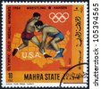 SOUTH ARABIA - CIRCA 1968: stamp printed in Mahra State of South Arabia shows an image of American sportsman Hansen, winner in wrestling in Olympic Games  St. Louis , Missouri 1904, series, circa 1968 - stock photo