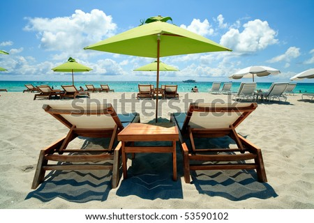 South Beach Lounge Chairs and Umbrellas - stock photo