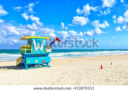 South Beach, Miami, Florida, lifeguard house in a colorful Art Deco style on cloudy blue sky and Atlantic Ocean in background, world famous travel location - stock photo