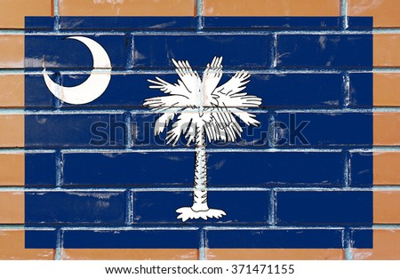 South Carolina state flag of America on brick wall - stock photo