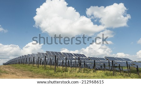 South Central Wisconsin - August 19, 2014  Solar panel farm in south central Wisconsin with clouds and sky.