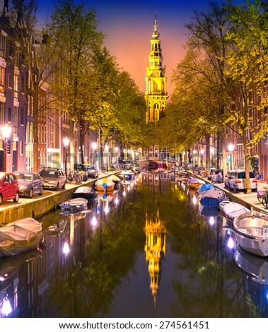 South Church Zuiderkerk and Amsterdam Canals at dusk. Night time illuminations of buildings with reflections on water. Netherland, Europe. - stock photo