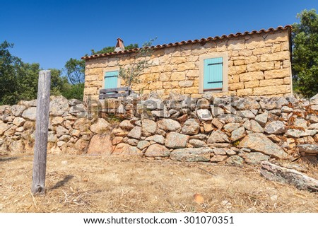 South Corsica, rural landscape with old typically small house made of yellow stones - stock photo