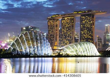 South East Asia, Singapore, December 6th 2015 Gardens by the Bay, Cloud Forest, Flower Dome, Marina Bay Sands Hotel and Casino - stock photo