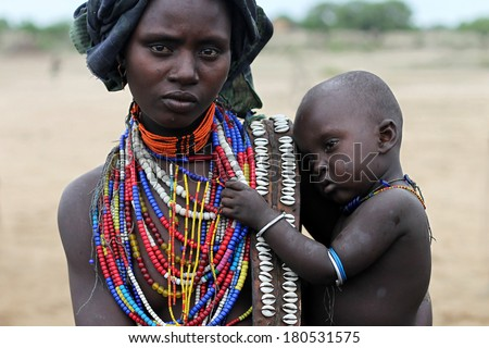SOUTH ETHIOPIA, AFRICA - DEC 27, 2009 Unidentified Mother and her son - Arbore tribe - stock photo