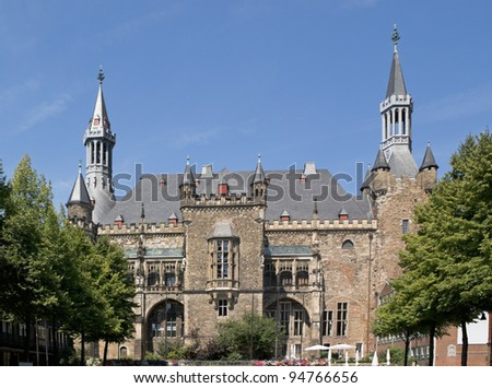 South facade of Aachen (Aix-la-Chapelle) town hall against blue sky