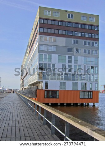 South facade of Silodam, Amsterdam, Netherlands. Silodam, a block containing 157 apartments, was built in 2002 and named after nearby grain silos. It is now a well known landmark of modern Amsterdam. - stock photo