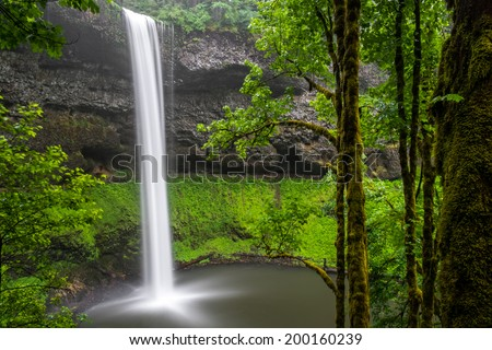 South Falls at Silver Falls State Park in Oregon. The park, which is the largest state park in Oregon, boasts many of the most beautiful waterfalls found in the state. - stock photo