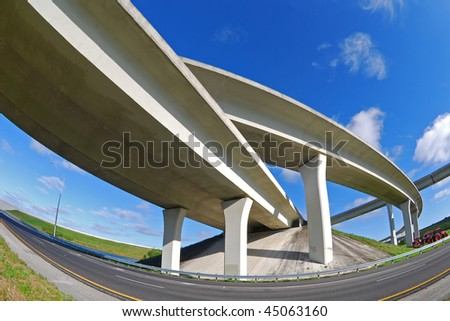 South Florida expressway winds and turns overhead. - stock photo