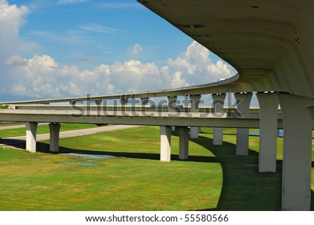 South Florida expressways with blue skies and green grass.