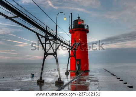 South Haven Lighthouse at Dawn with Light On - stock photo