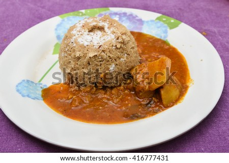 South Indian breakfast puttu made of whole wheat and coconut, with chicken curry, Kerala, India.