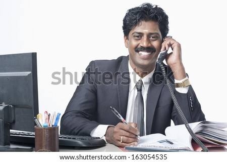 South Indian businessman working in an office