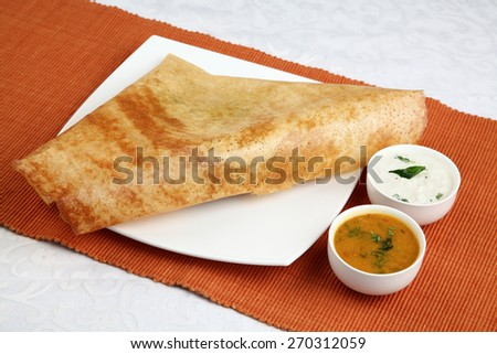 South Indian  Dosa with vegetable sagu and coconut chutney,Masala Dosa with Chutney   and Sambaar, Traditionally a South Indian Dish        - stock photo