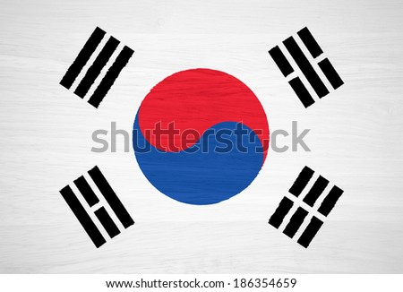 South Korea flag on wood texture - stock photo