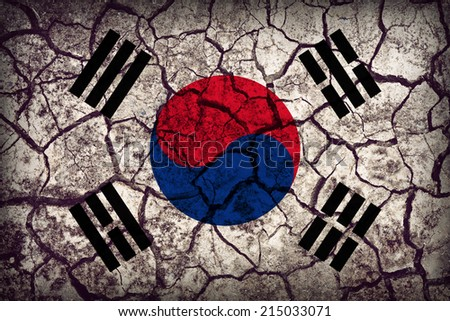 South Korea flag pattern on the crack soil texture ,retro vintage style - stock photo