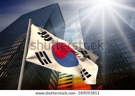 South korea national flag against low angle view of skyscrapers at sunset - stock photo
