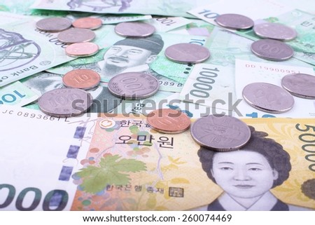 South Korean bank notes and coins background - stock photo