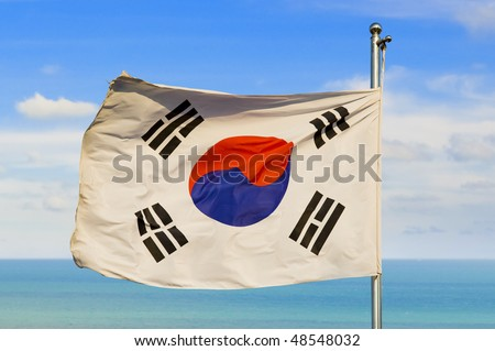 south korean flag on a pole against beautiful sky over horizon on water - stock photo