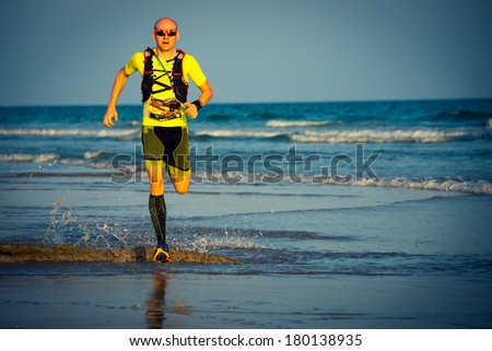 SOUTH OMAN - JANUARY 30: Italian runner Ivan Zufferli running at finish of extreme endurance marathon Transomania 2014. Marathon is with 300 km in mountains and desert one of the hardest ever made. - stock photo