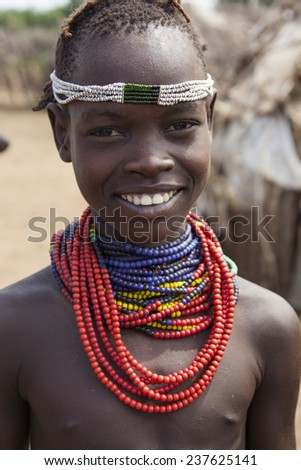 SOUTH OMO - ETHIOPIA - NOVEMBER 23, 2011: Portrait of the unidentified boy from the African tribe Dasanech, in November 23, 2011 in Omo Rift Valley, Ethiopia. - stock photo