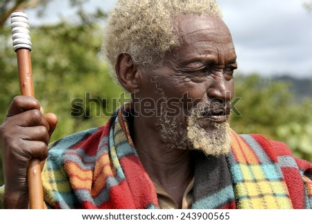 SOUTH OMO - ETHIOPIA - NOVEMBER 26, 2011: Portrait of the unidentified old man from Ethiopia, in November 26, 2011 in Omo Rift Valley, Ethiopia. - stock photo